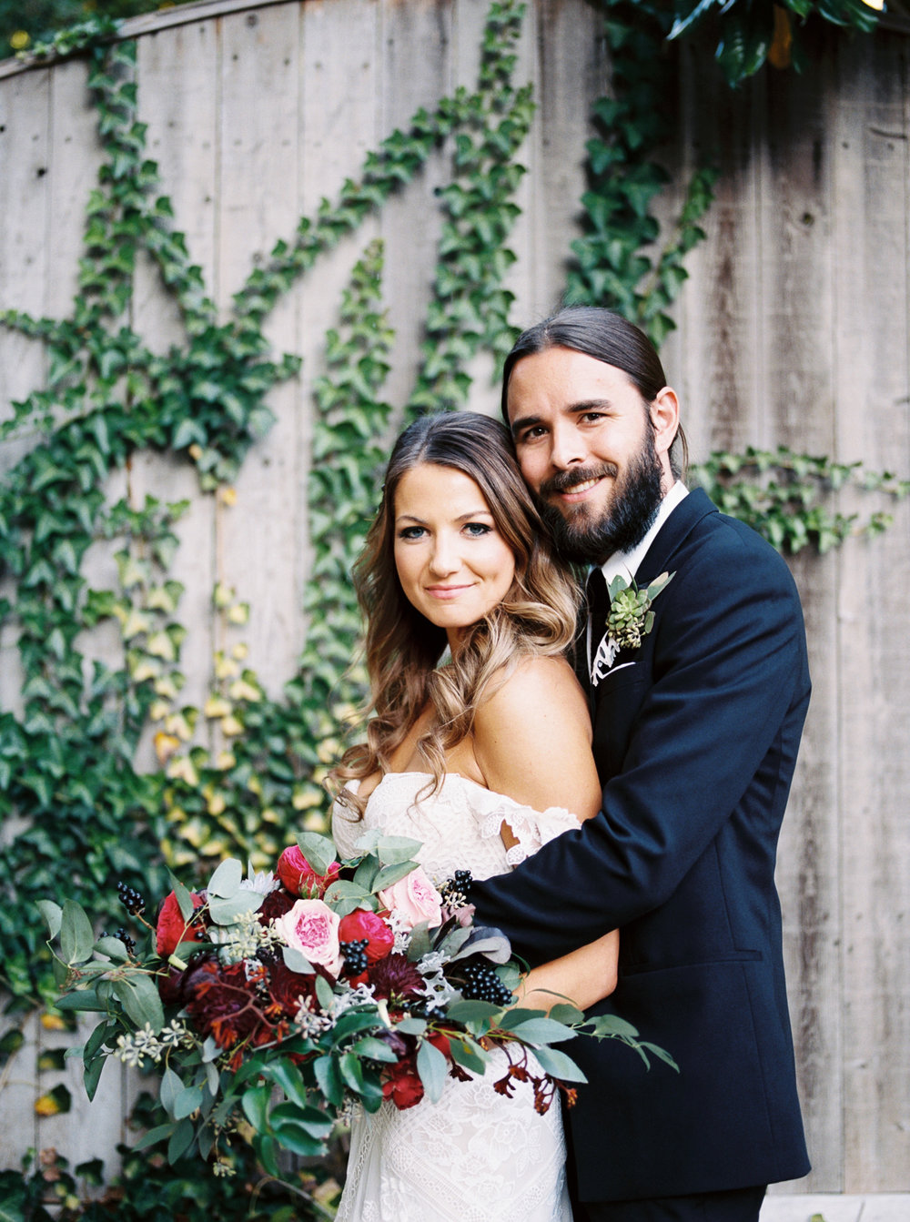 Stylish bride and groom with marsala, wine, and berry toned wedding flowers // Franklin, TN Wedding Florist