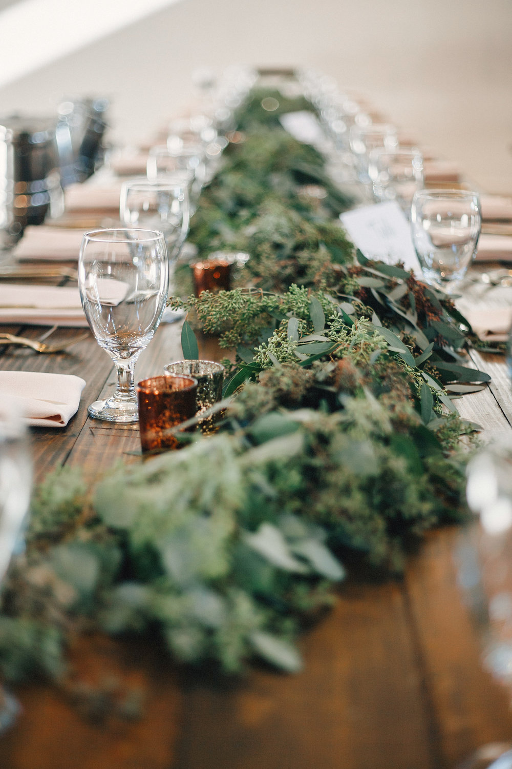 Lush greenery garland runner on farm tables // Nashville Wedding Floral Design