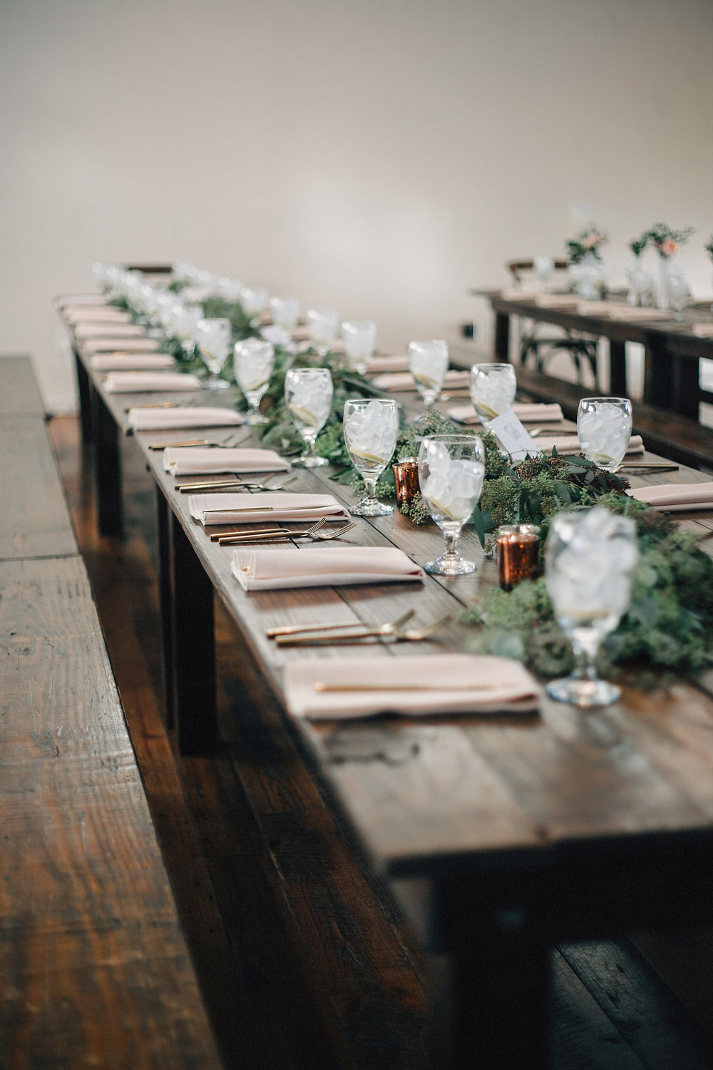 Eucalyptus garland on farm tables at the Cordelle // Nashville Wedding Florist