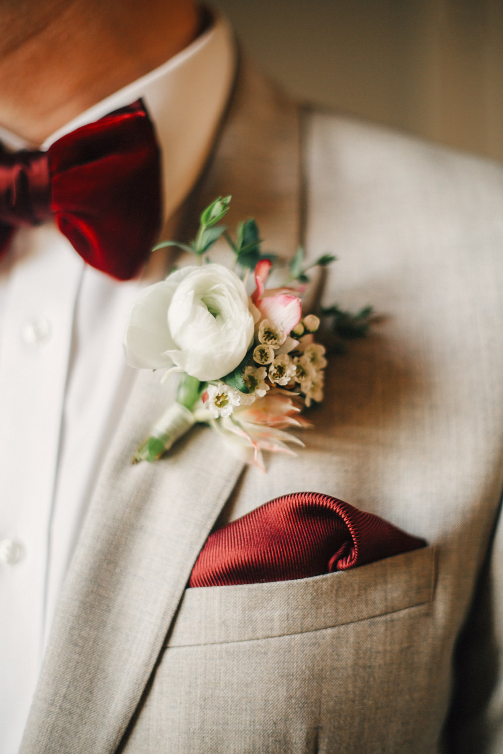 White Ranunculus Boutonniere and Red Velvet Bow Tie // Nashville Fall Wedding Florist