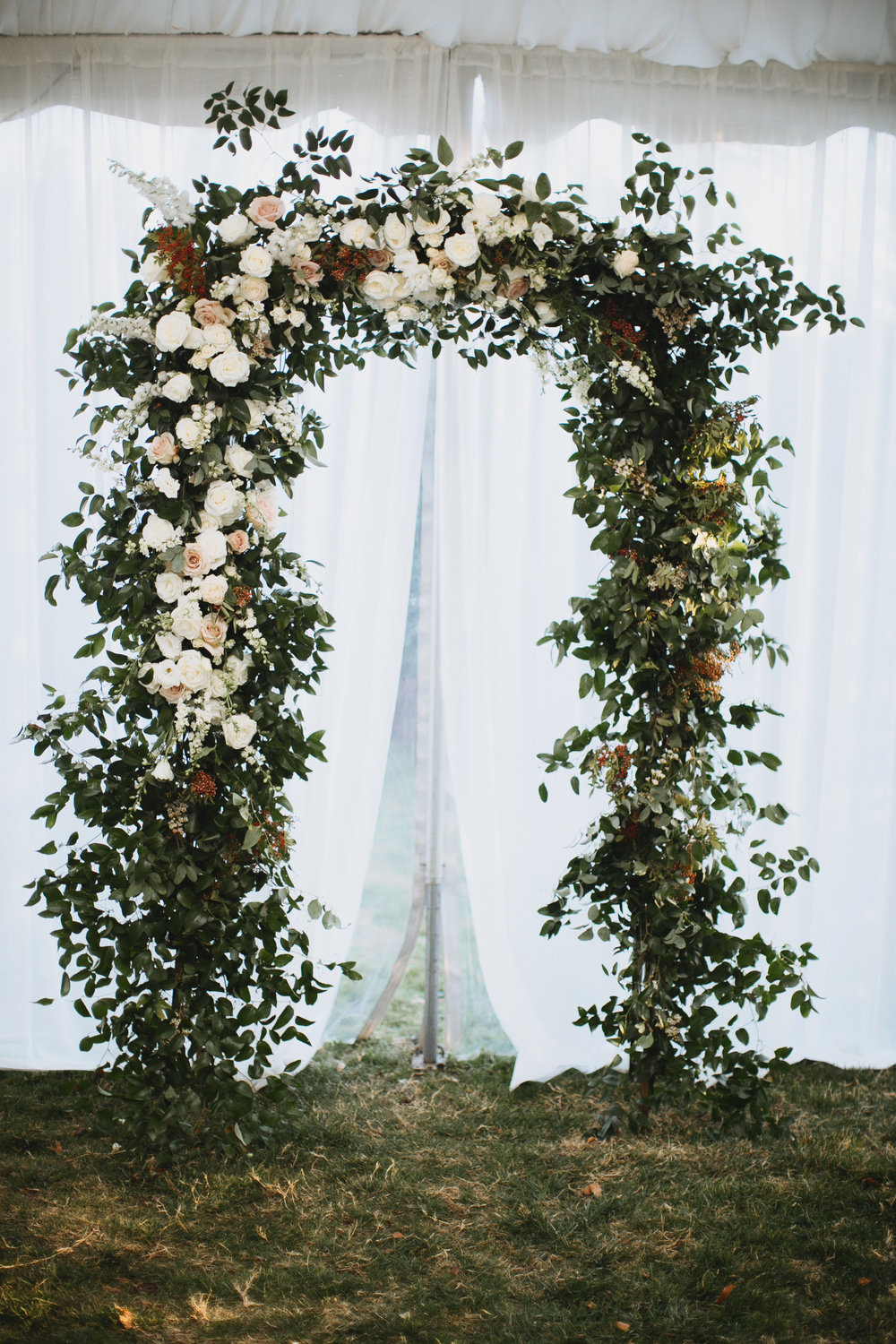 Lush Arch with lots of greenery and white and blush florals // Nashville Wedding Floral Design