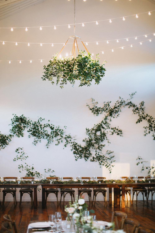 Loose vine like / greenery installation on large white wall // Nashville Wedding Florist
