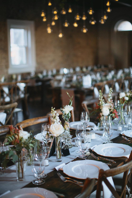 Bud Vases and candles on farm tables // Nashville Wedding Floral Design