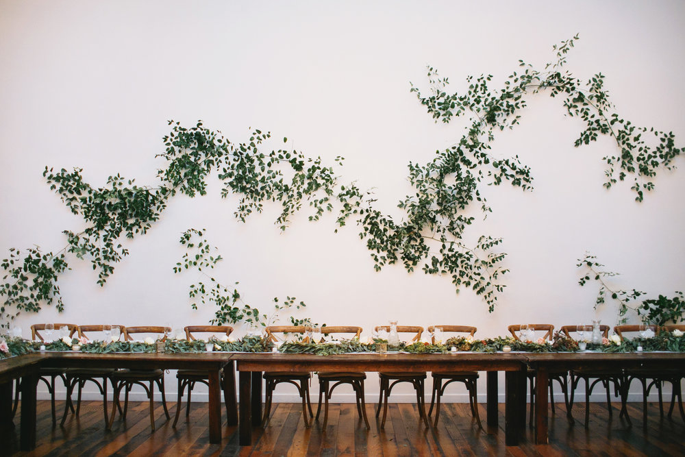 Large greenery vine installation on a white wall //Nashville Wedding Florist