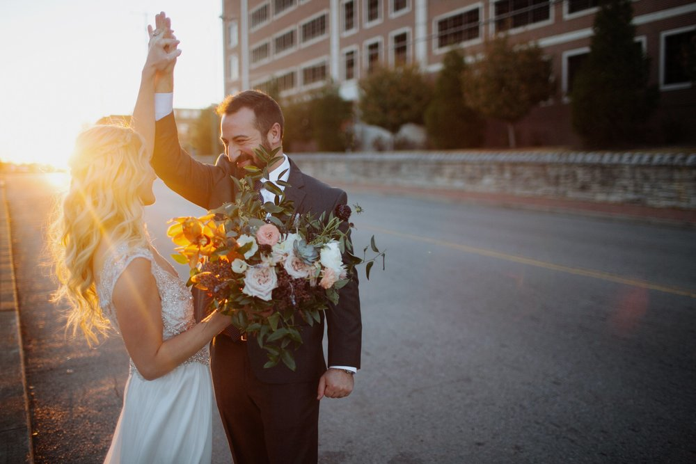 Newlyweds dancing in the street! Organic floral design in Nashville, TN.