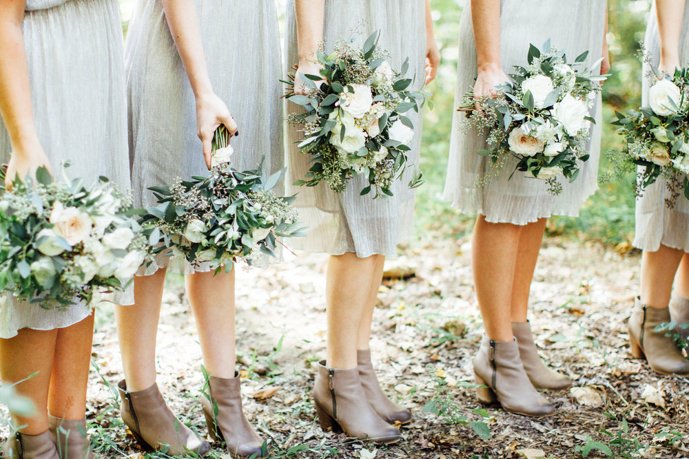 Lush bridesmaid bouquets with lots of greenery and cute boots // Nashville Wedding Floral Design