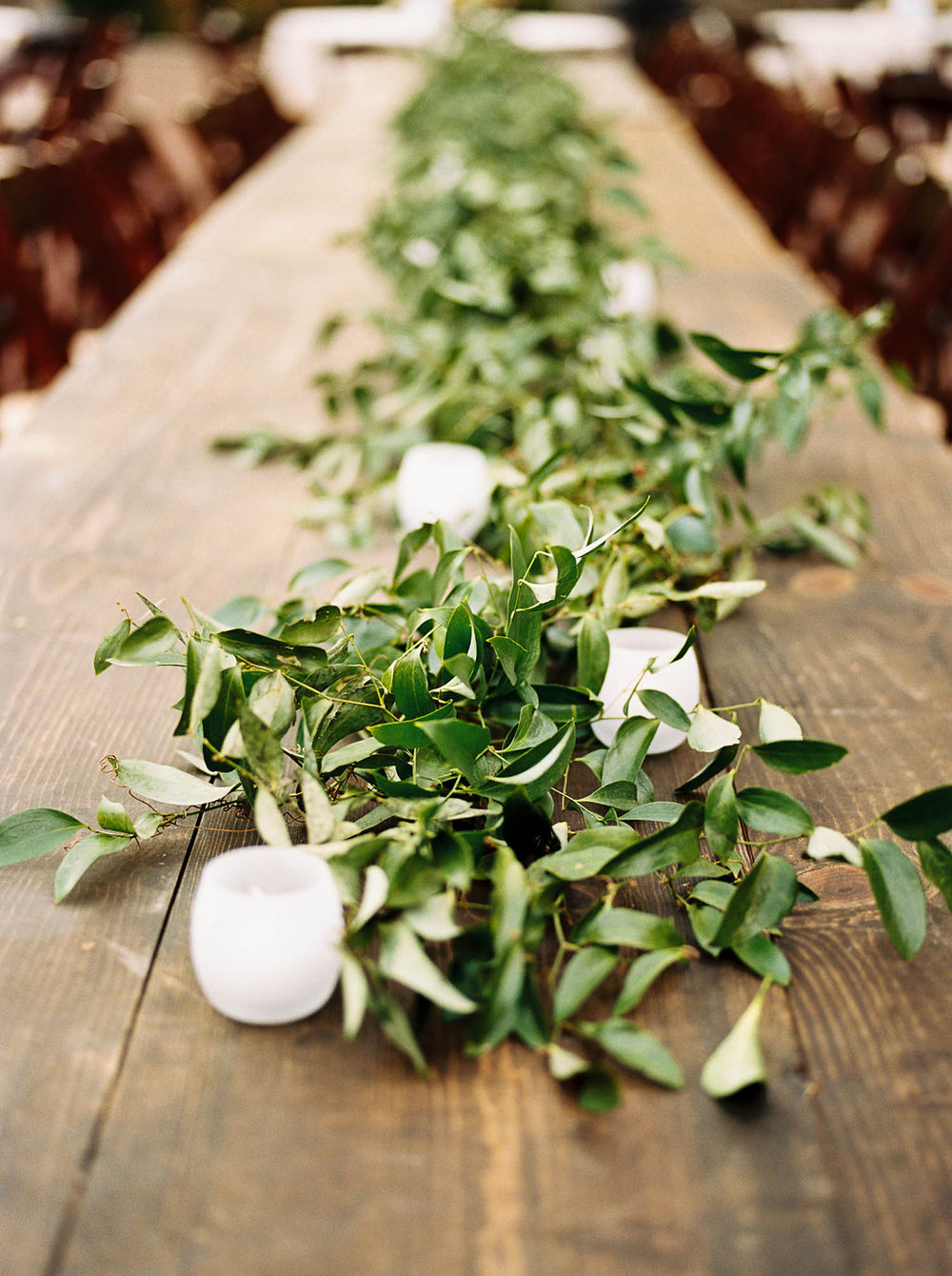 Lush greenery garland for the head table // Nashville Wedding Florist
