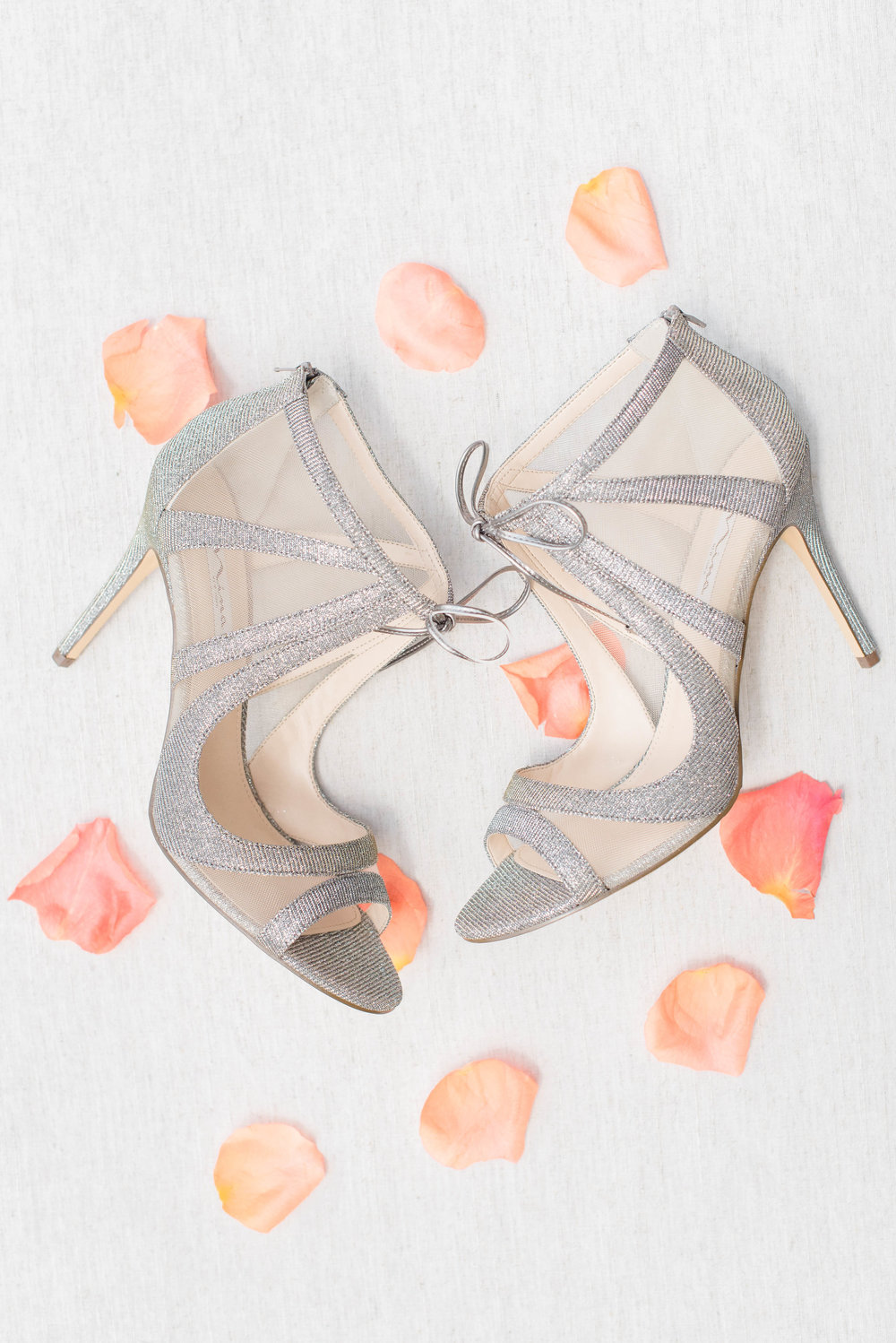 Bridal shoes with rose petals // Nashville Wedding Floral Design