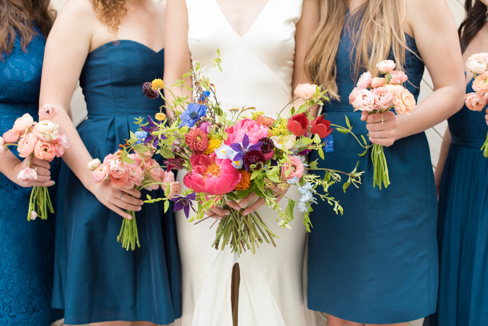 Lush, bright bridal bouquet // Peach ranunculus bridesmaid bouquets // Chagall Painting Inspired Wedding Flowers