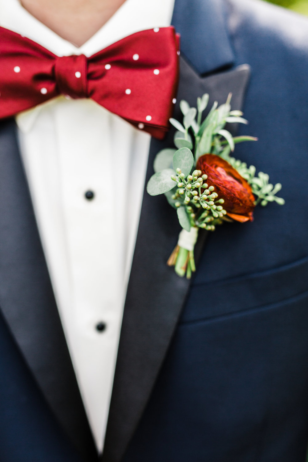Deep red ranunculus boutonniere // Nashville Wedding Florist