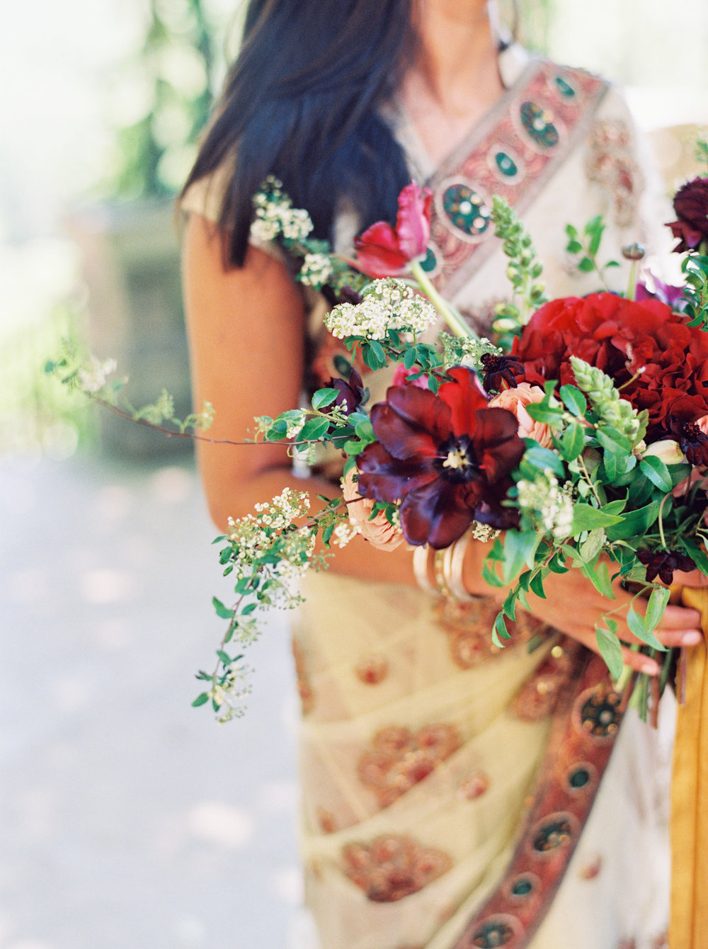 Marsala and plum bouquet of ranunculus, peonies, tulips, and lush greenery // Nashville Wedding Florist