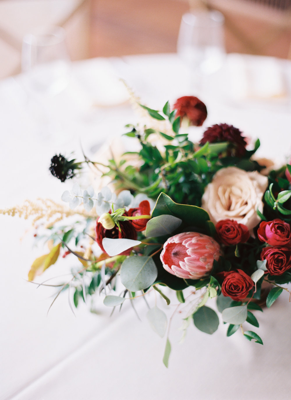 Marsala dahlias, peach astilbe, protea, and natural greenery // Nashville Wedding Florist