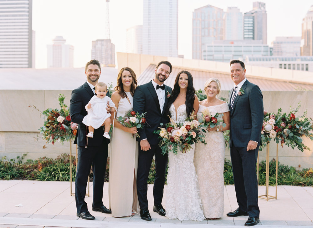 Family portraits with the Nashville skyline // Lush, untamed wedding flowers