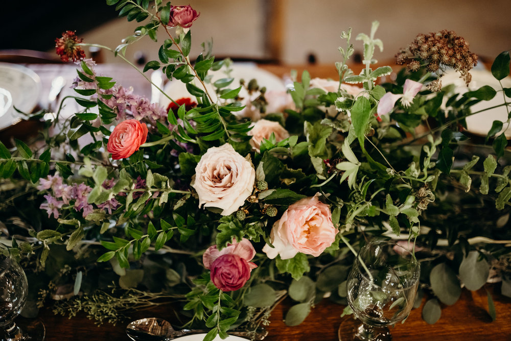 Natural floral arrangement with garden roses, ranunculus, and chocolate laceflower // Meadow Hill Farm Wedding