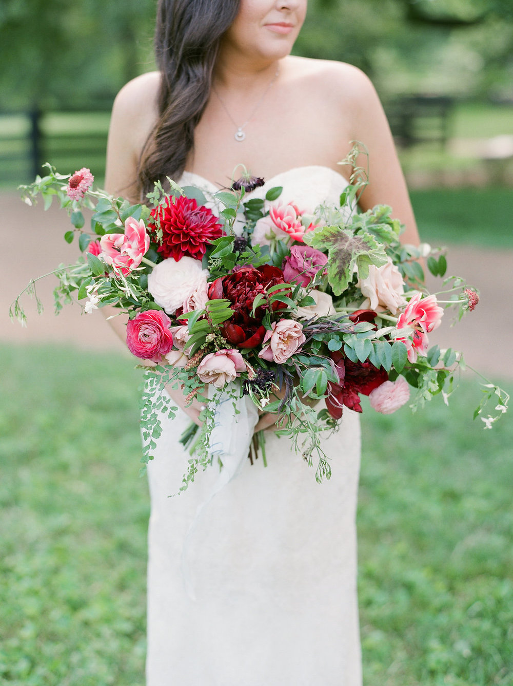 Lush bridal bouquet with marsala dahlias, pink tulips, burgundy peonies, pink ranunculus, and maidenhair fern // Nashville Wedding Floral Design