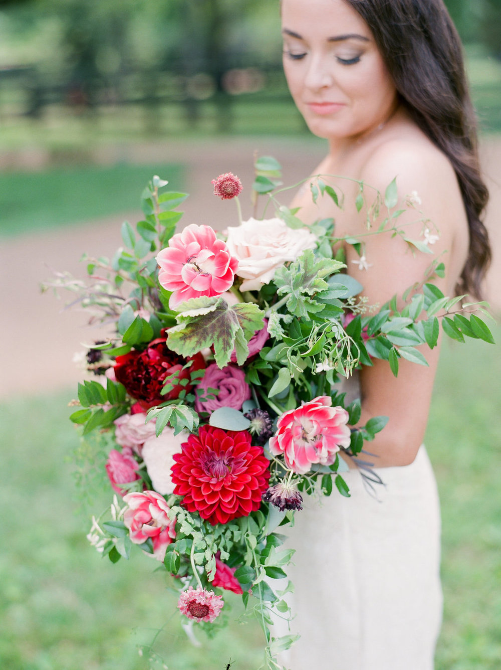 Lush bridal bouquet with marsala dahlias, pink tulips, burgundy peonies, pink ranunculus, and maidenhair fern // Belle Meade Wedding Floral Design