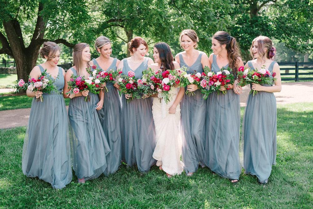 Lush bridal bouquet with marsala dahlias, pink tulips, burgundy peonies, pink ranunculus, and maidenhair fern, gray bridesmaid dresses // Belle Meade Wedding Floral Design