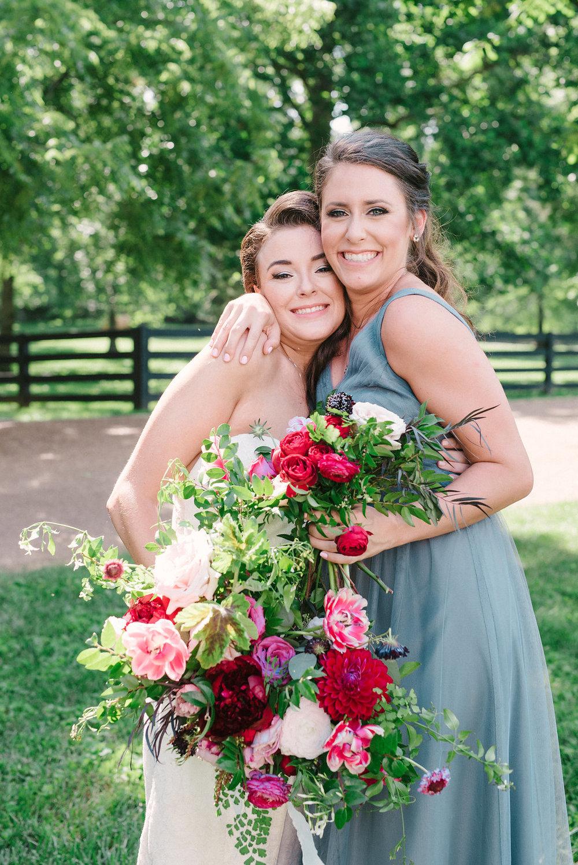 Lush bridal bouquet with marsala dahlias, pink tulips, burgundy peonies, pink ranunculus, and maidenhair fern // Belle Meade Wedding Floral Design