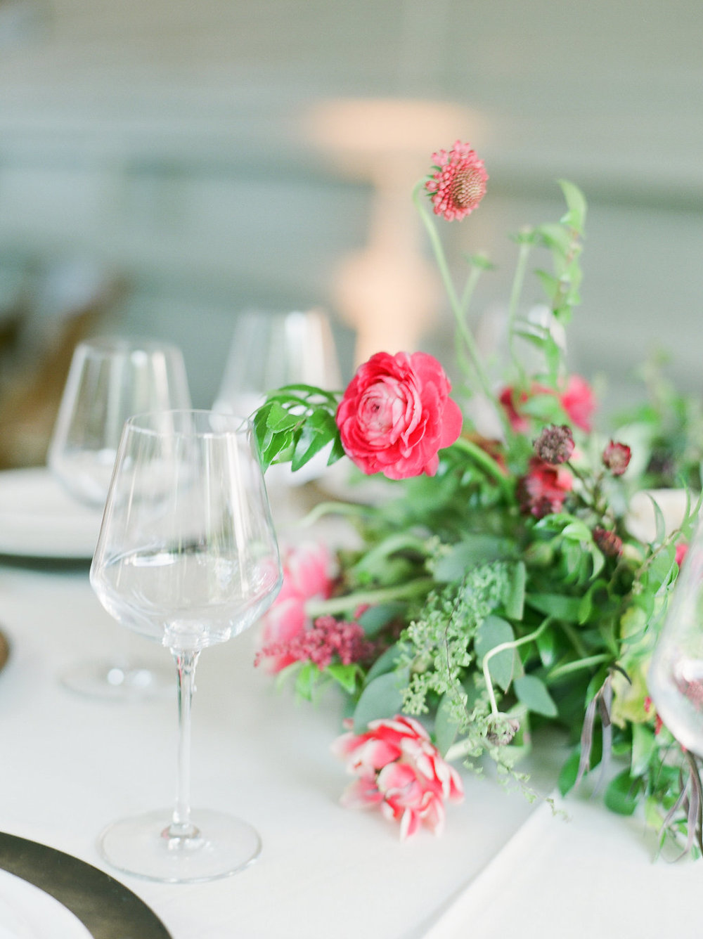 Pink and marsala centerpiece with ranunculus and tulips // Nashville Wedding Florist