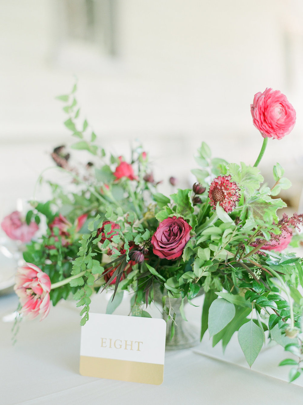 Raspberry and marsala floral centerpiece with ranunculus, tulips, and garden roses // Nashville Wedding Florist