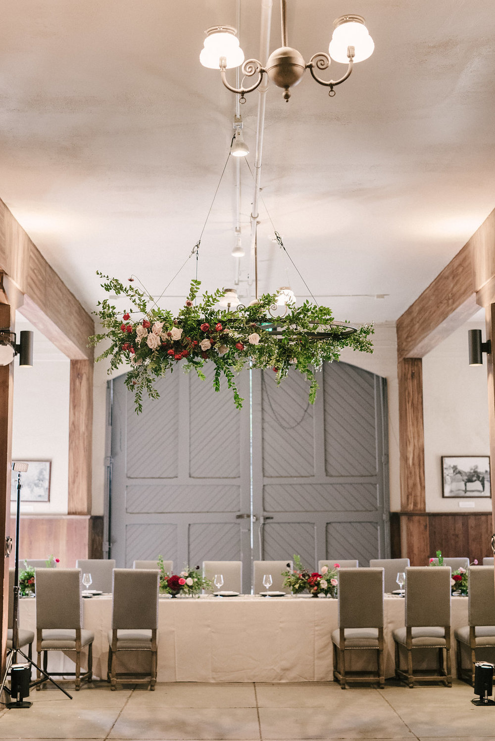 Raspberry and marsala floral centerpiece with ranunculus, tulips, and garden roses // Nashville Wedding Florist // Belle Meade Plantation Carriage House Reception