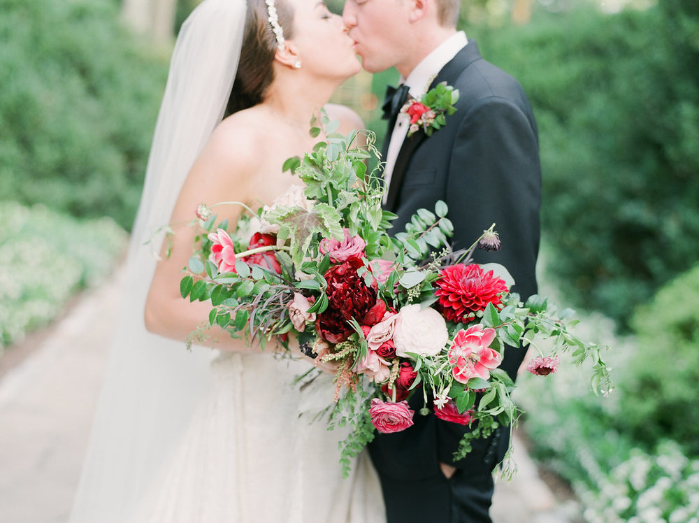 Lush bridal bouquet with marsala and raspberry flowers and natural greenery // Nashville Wedding Flowers