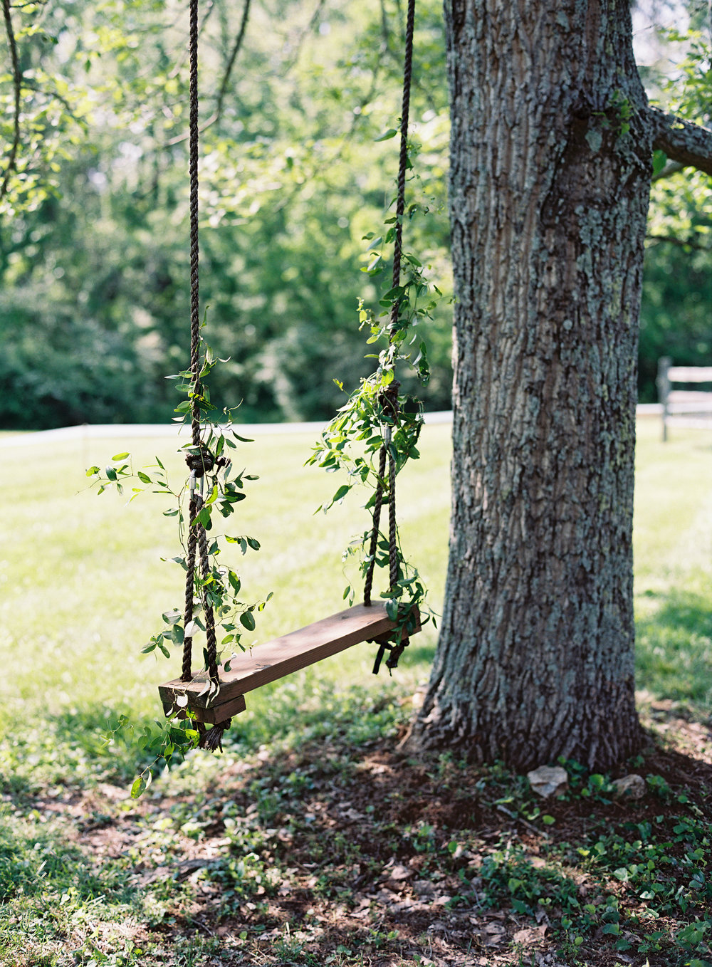 Delicate vines on a wooden swing // Nashville Wedding Floral Design