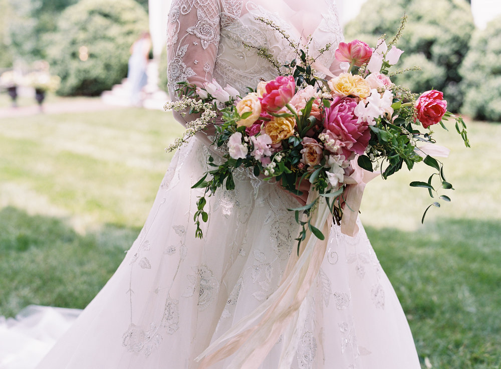 Lush bridal bouquet of pink peonies, tulips, lily of the valley, garden roses, and blush sweet peas  // Nashville Wedding Floral Design