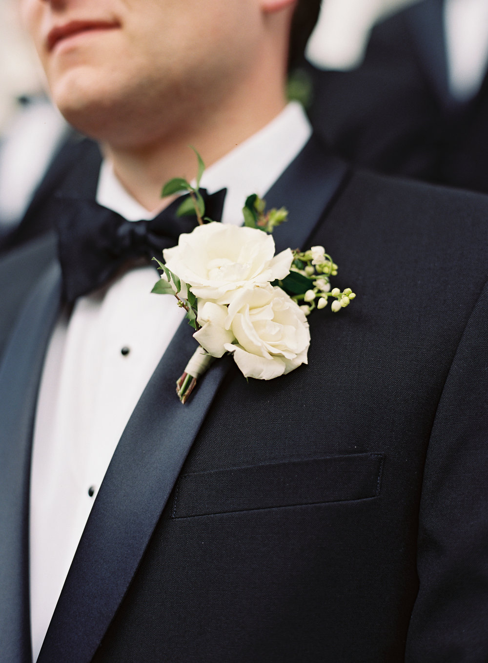 Classic groom style--black tux and white floral boutonniere // Franklin Wedding Florist
