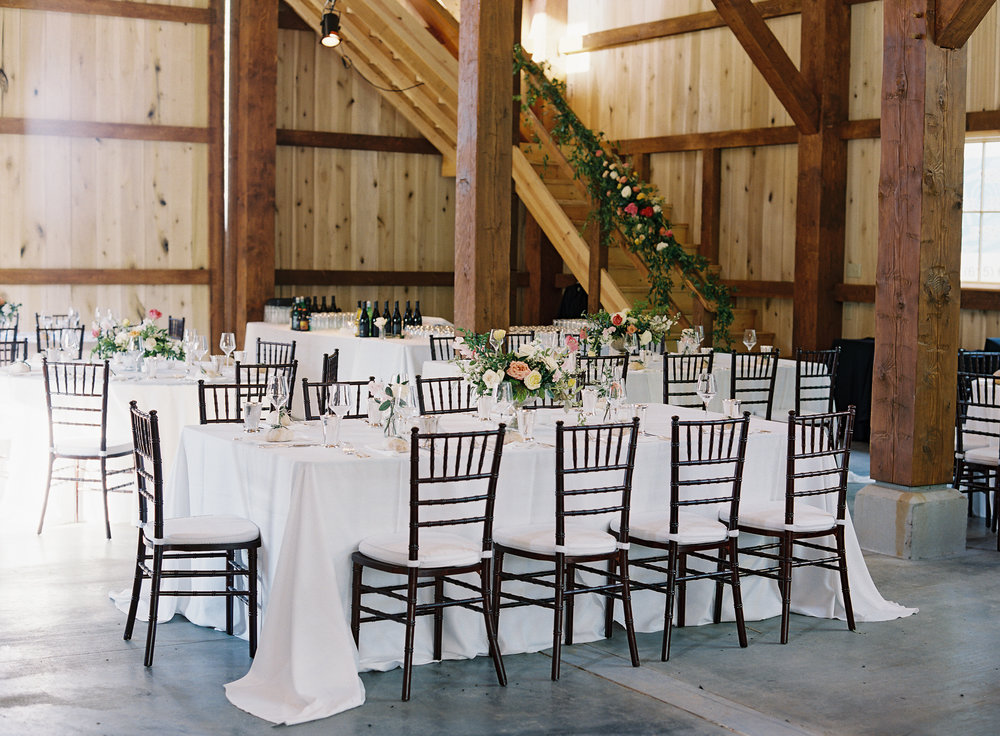 Upscale barn wedding with Silver compote centerpieces with natural greenery, peach garden roses, pink tulips, and spirea // Nashville Wedding Floral Design