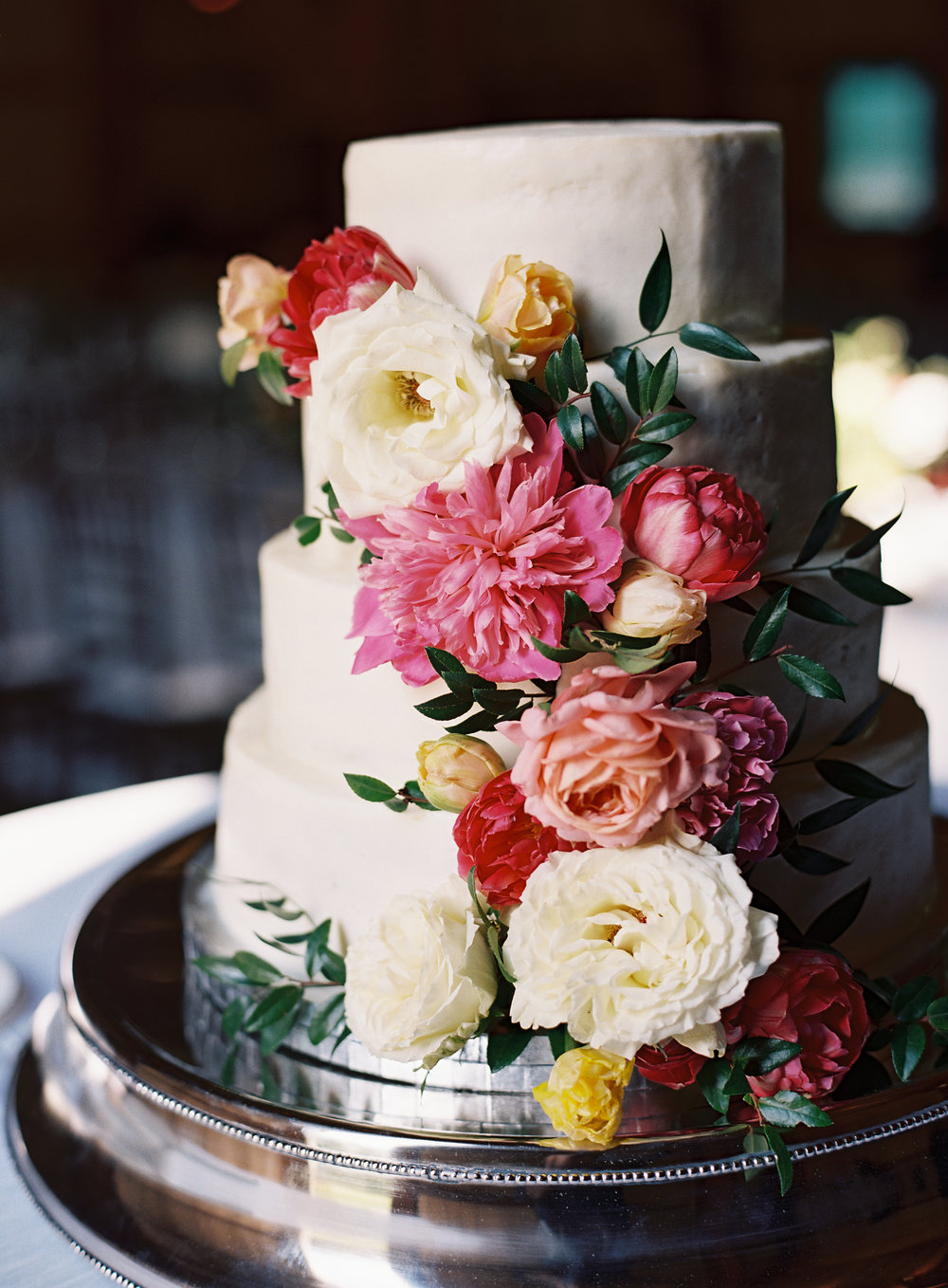 Wedding cake with lush florals--pink peonies, garden roses, tulips, and greenery // Nashville Wedding Florist