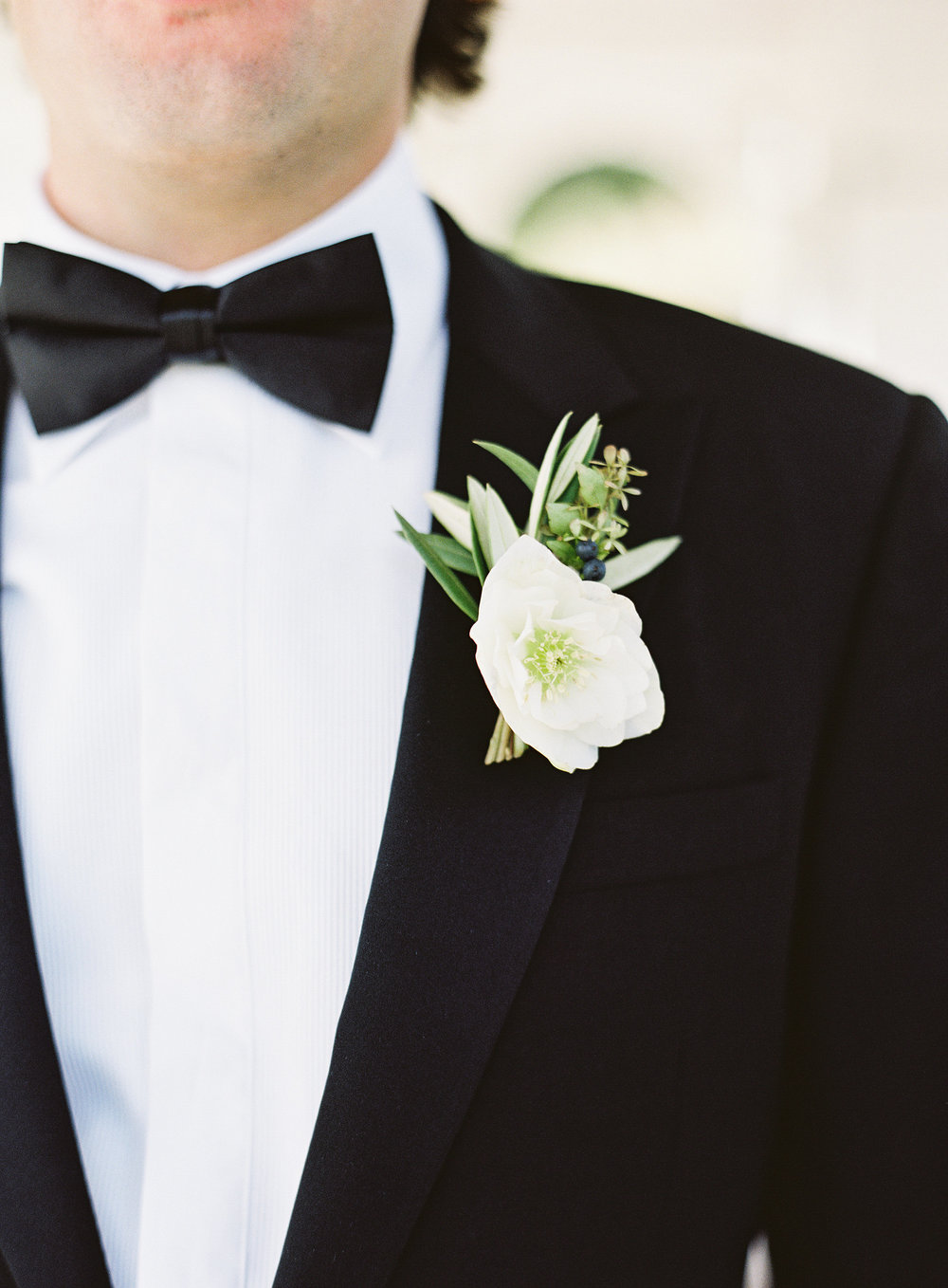 Hellebore and greenery boutonniere // Blackberry Farm Wedding Floral Design
