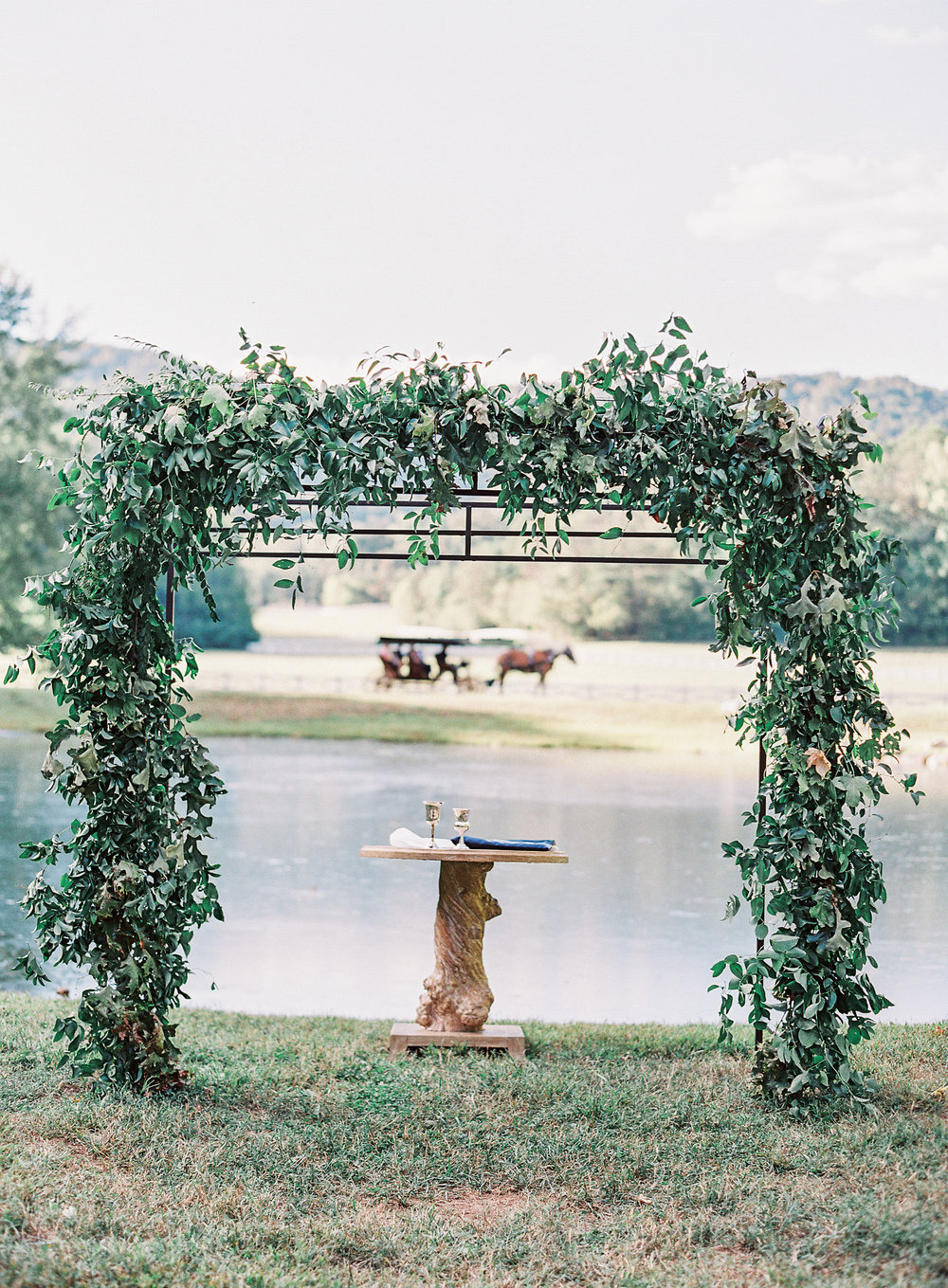 All greenery arch for the wedding ceremony // Blackberry Farm Wedding Floral Design