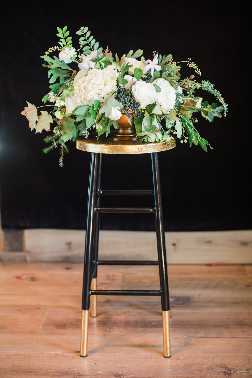 Lush centerpiece with all white flowers and organic greenery // Blackberry Farm Wedding Floral Design