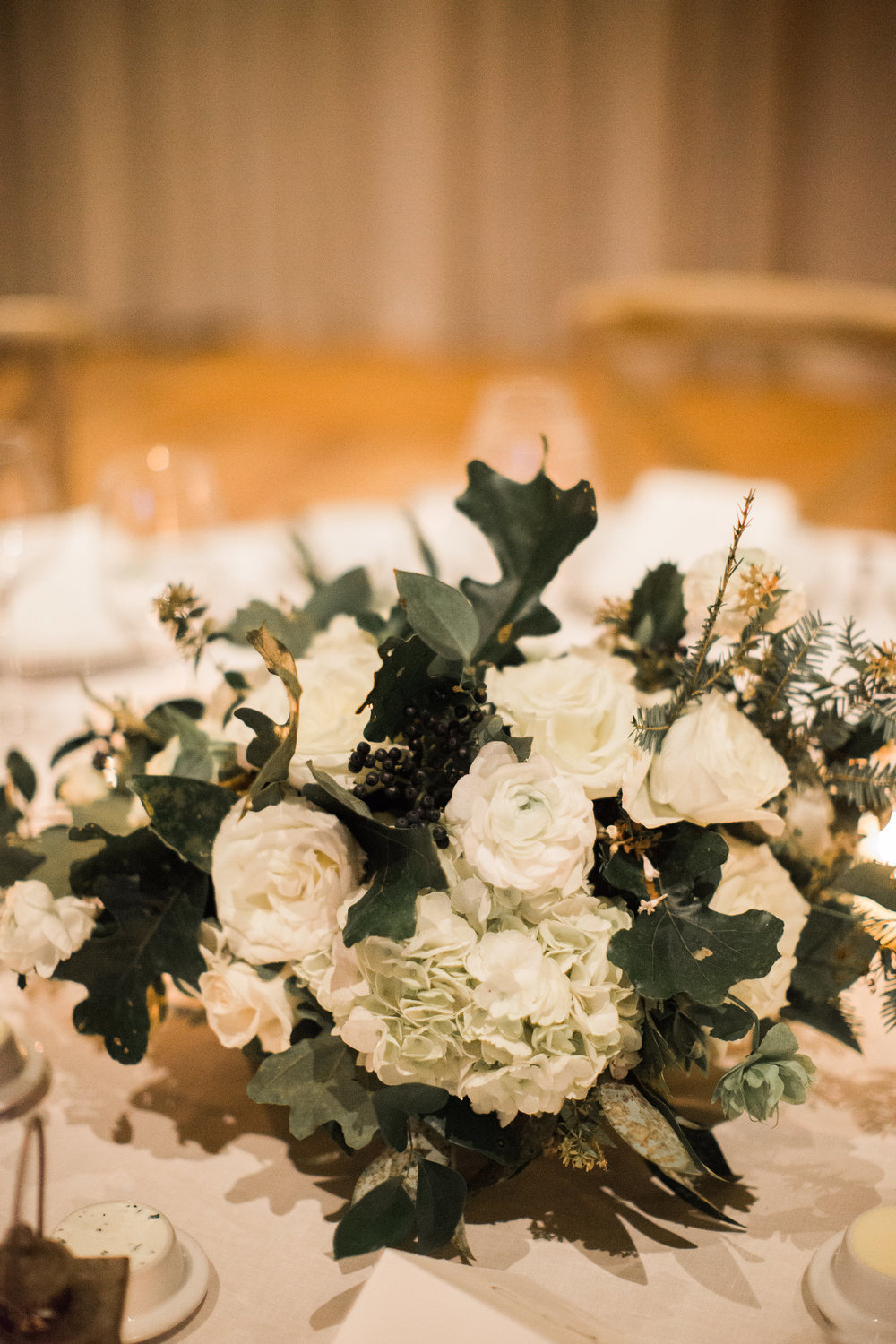Natural, untamed centerpiece with white flowers and greenery // Blackberry Farm Wedding Florist