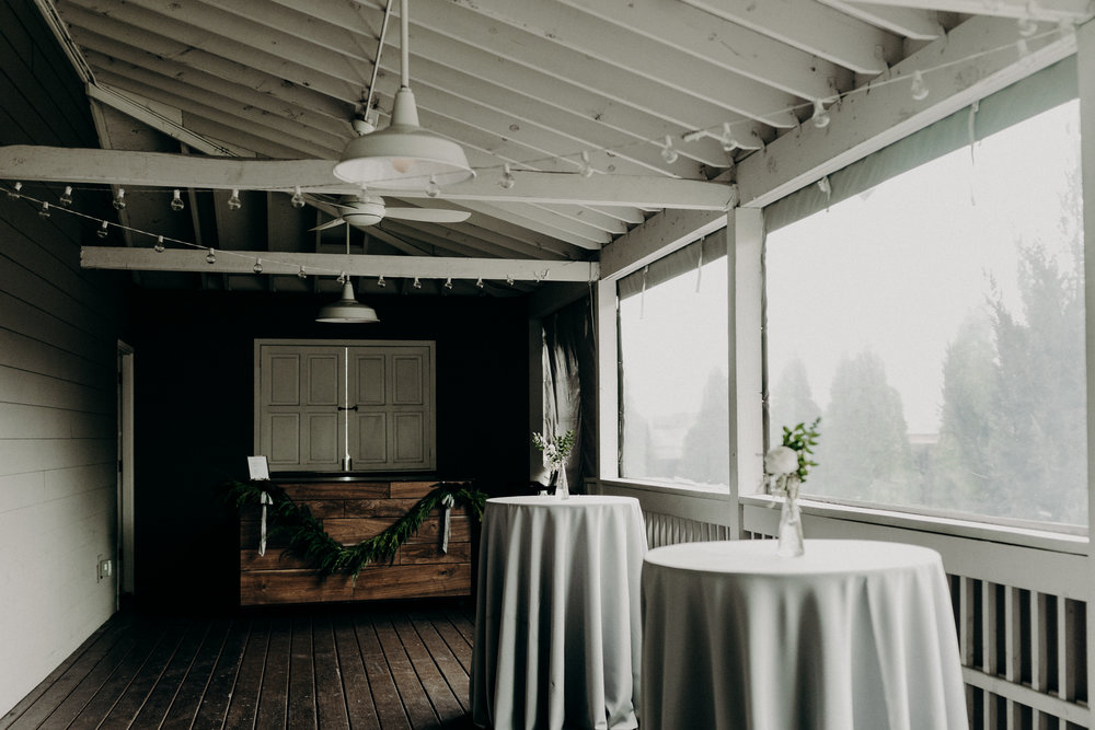 The Cordelle Porch--cedar garland and silk ribbon on the bars // Nashville Floral Design