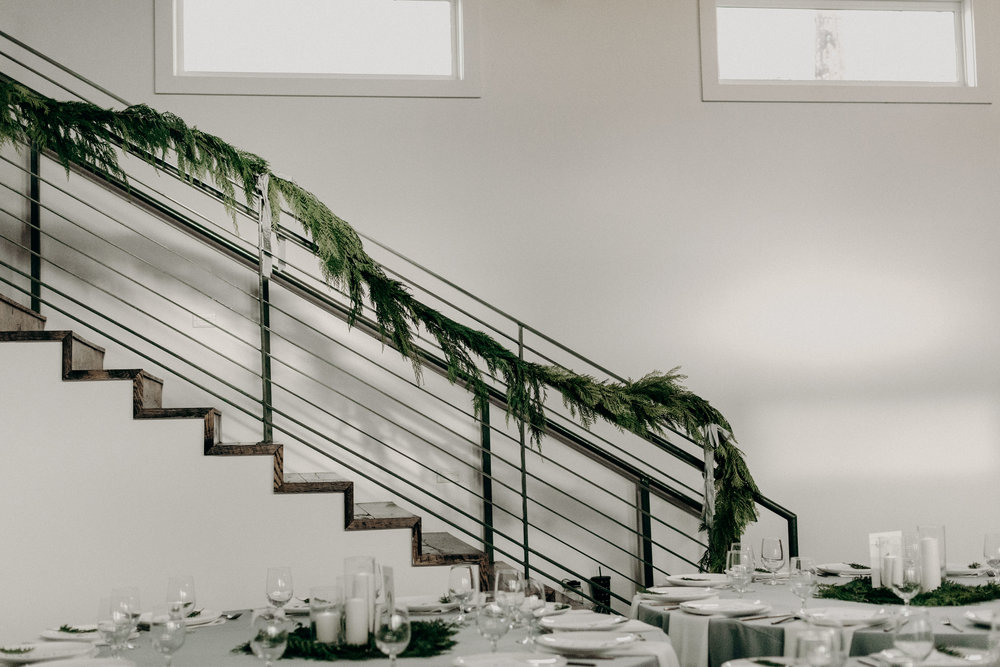 Cedar garland draping the stairwell at the Cordell // Nashville Wedding Floral Design
