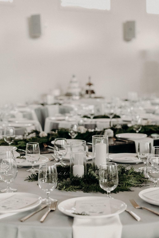Alaska inspired winter wedding // Lush greenery centerpieces with white pillar candles  // Nashville Wedding Florist