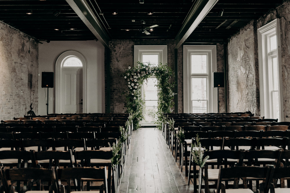 Wedding ceremony in the Victorian room at the Cordelle--lush, untamed floral arch  // Nashville Wedding Florist