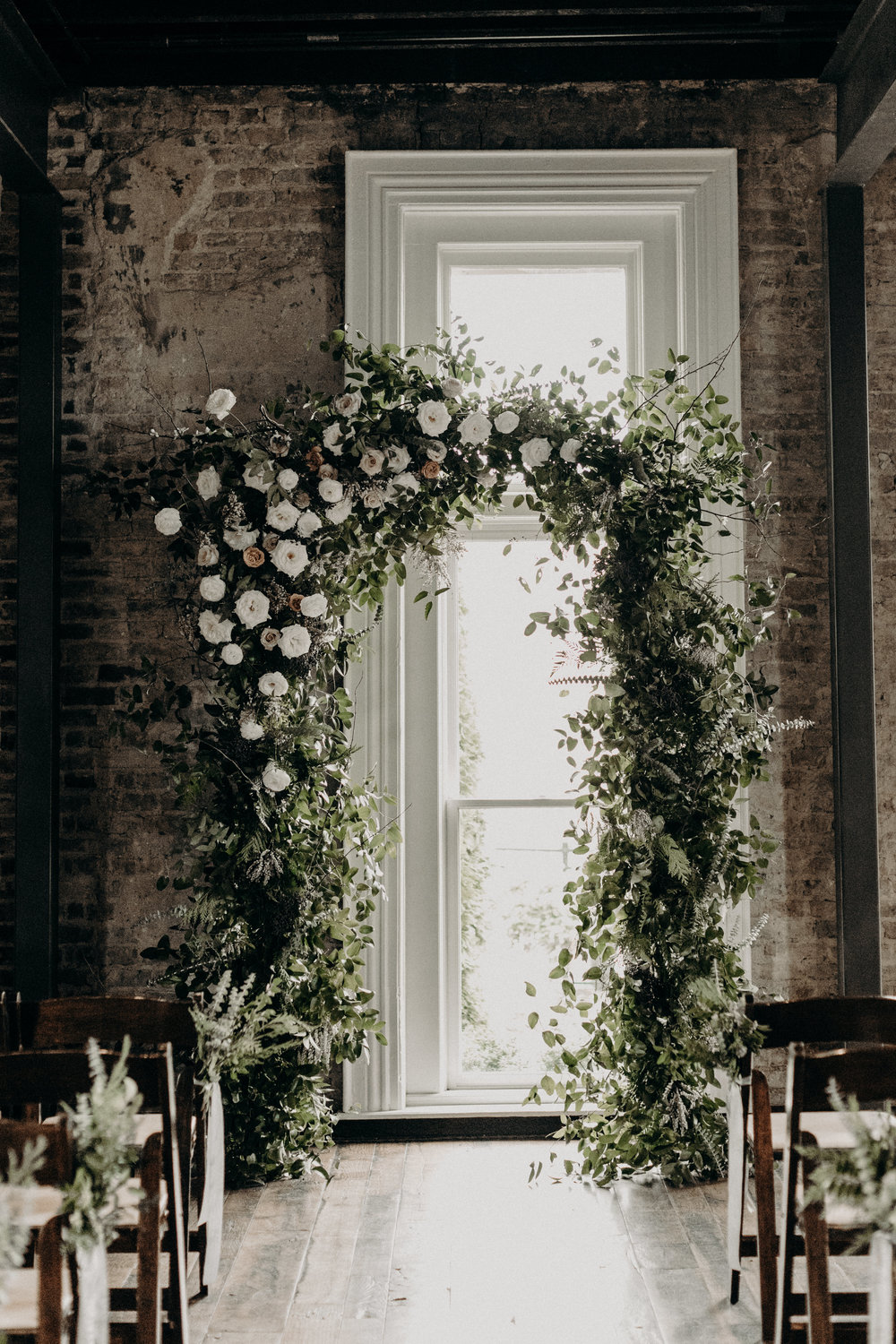 Lush, natural arch with organic greenery and neutral/ivory flowers  // Nashville Wedding Florist