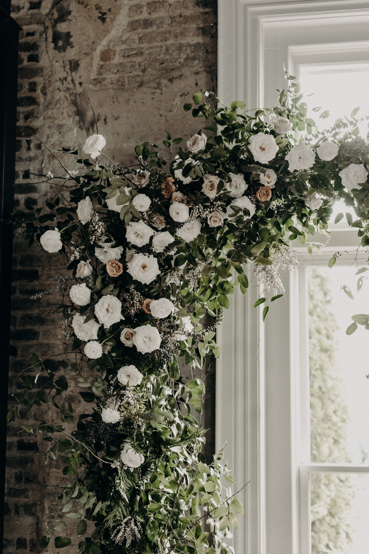 Wedding Ceremony arbor with lush greenery and white and neutral flowers // Alaska inspired winter wedding // Nashville Wedding Florist