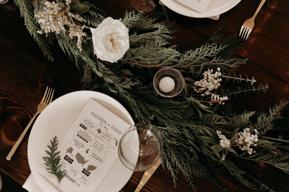 Alaska inspired winter wedding // Cedar table runners with white roses and pieris  // Nashville Wedding Florist
