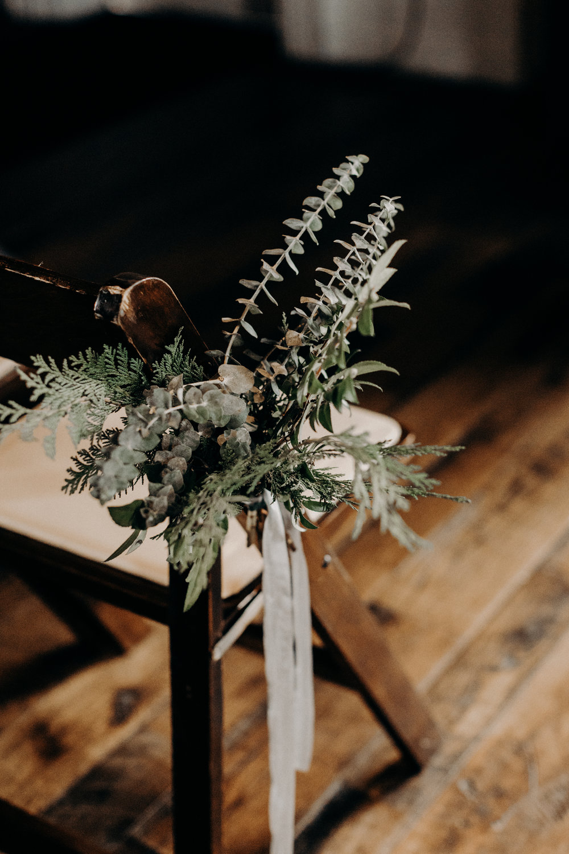 Lush greenery aisle markers tied on with grey silk ribbon  // Nashville Wedding Florist