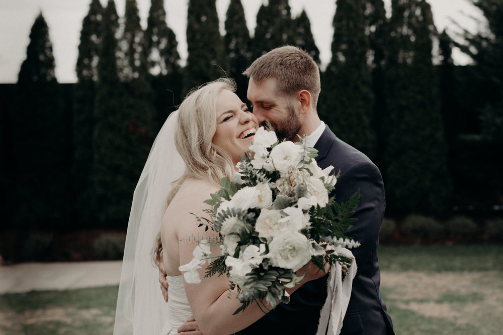 Lush winter bridal bouquet with all white flowers and evergreen accents  // Nashville Wedding Floral Design