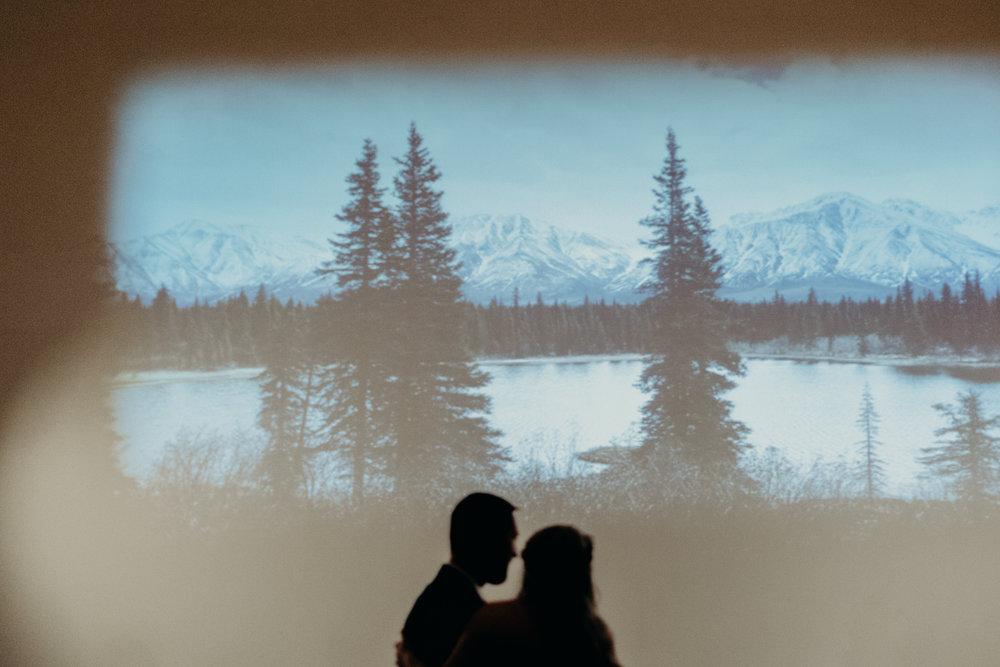 Alaska Mountains projected on a large white wall over the dancefloor  // Nashville Wedding Florist