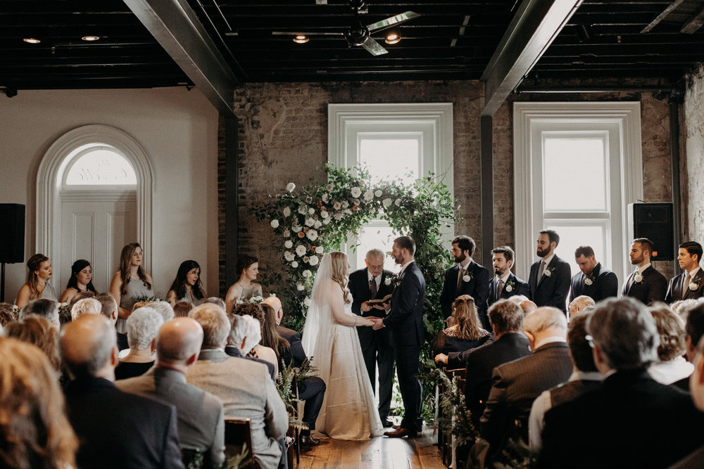 Winter wedding ceremony with a lush floral arch  // Nashville Wedding Floral Design