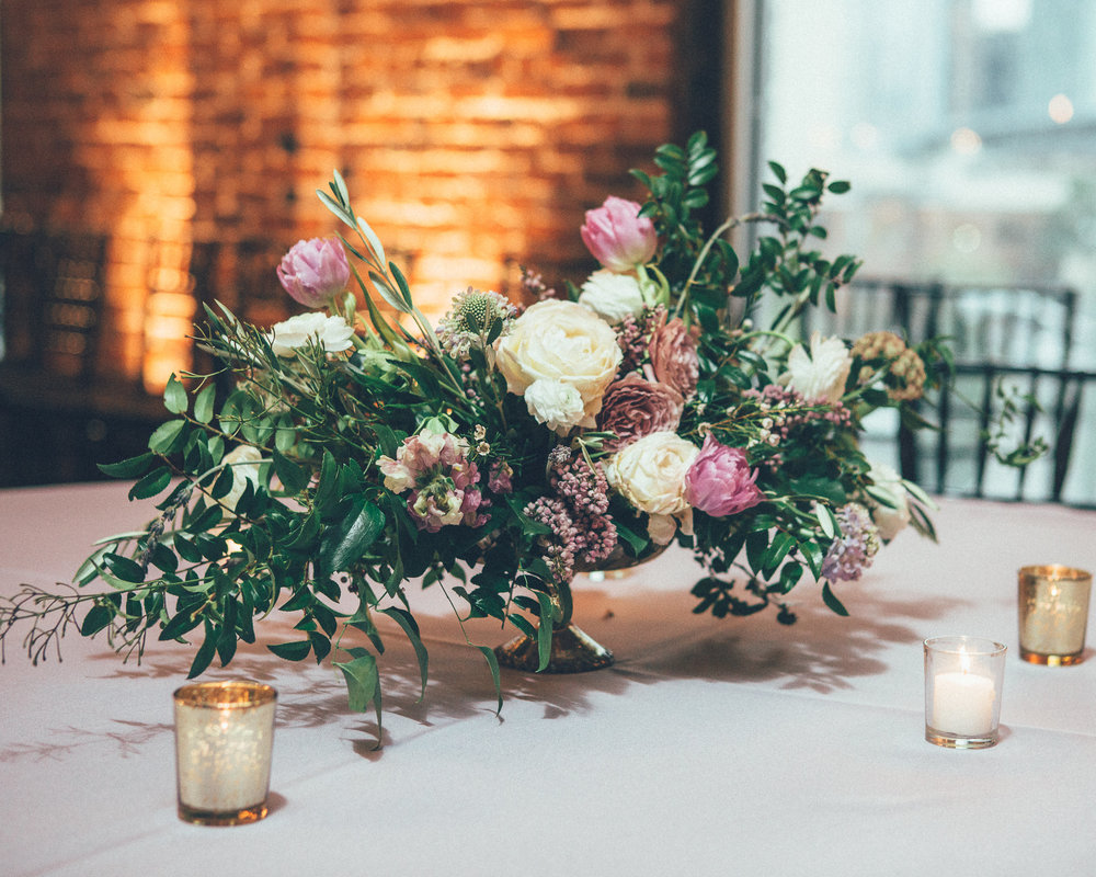 Low centerpiece with lavender flowers and organic greenery // Nashville Wedding Floral Design