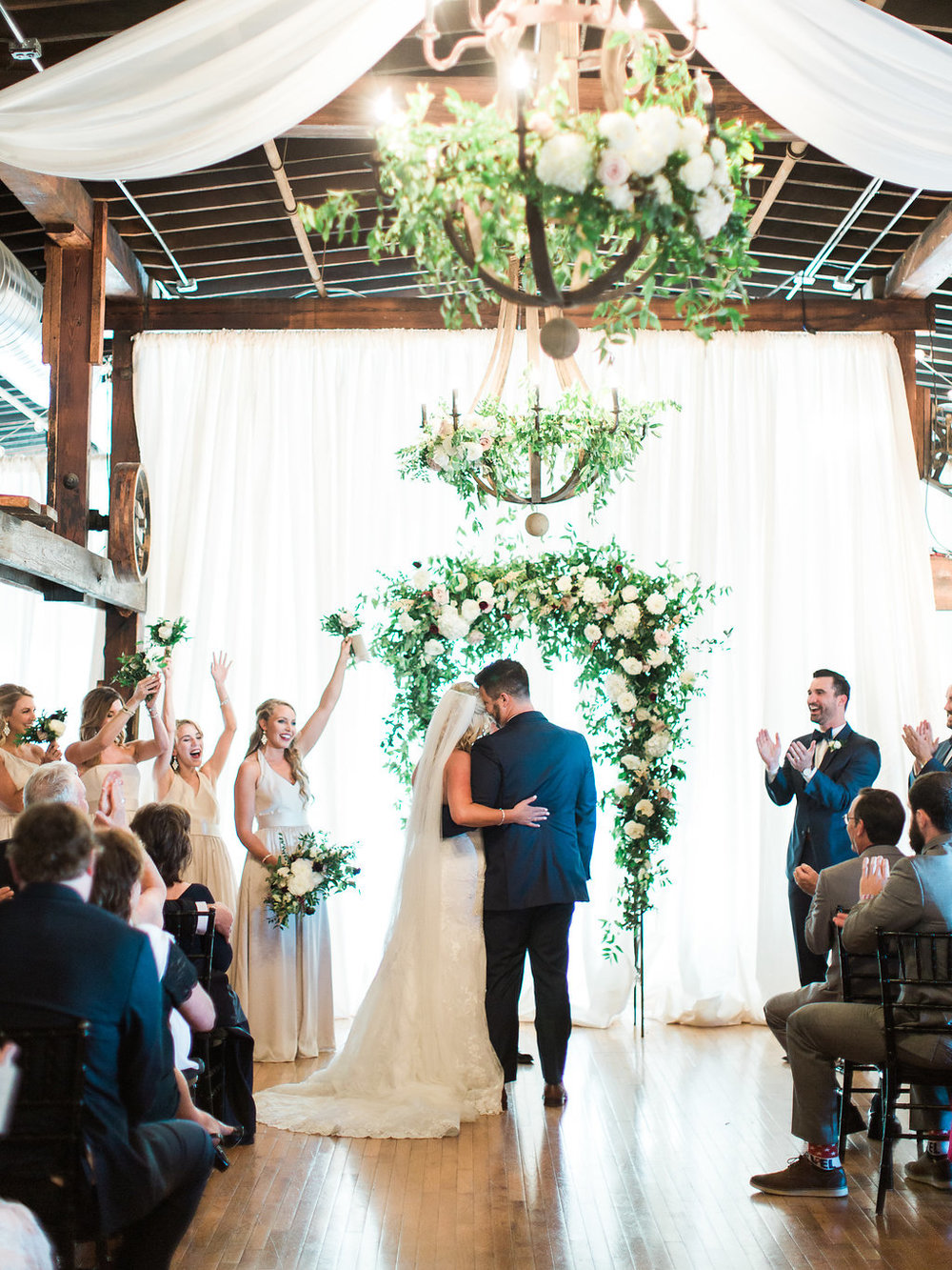 Lush wedding ceremony arch with natural greenery, blush and white flowers, and hints of marsala and burgundy // Nashville, TN Wedding Floral Design