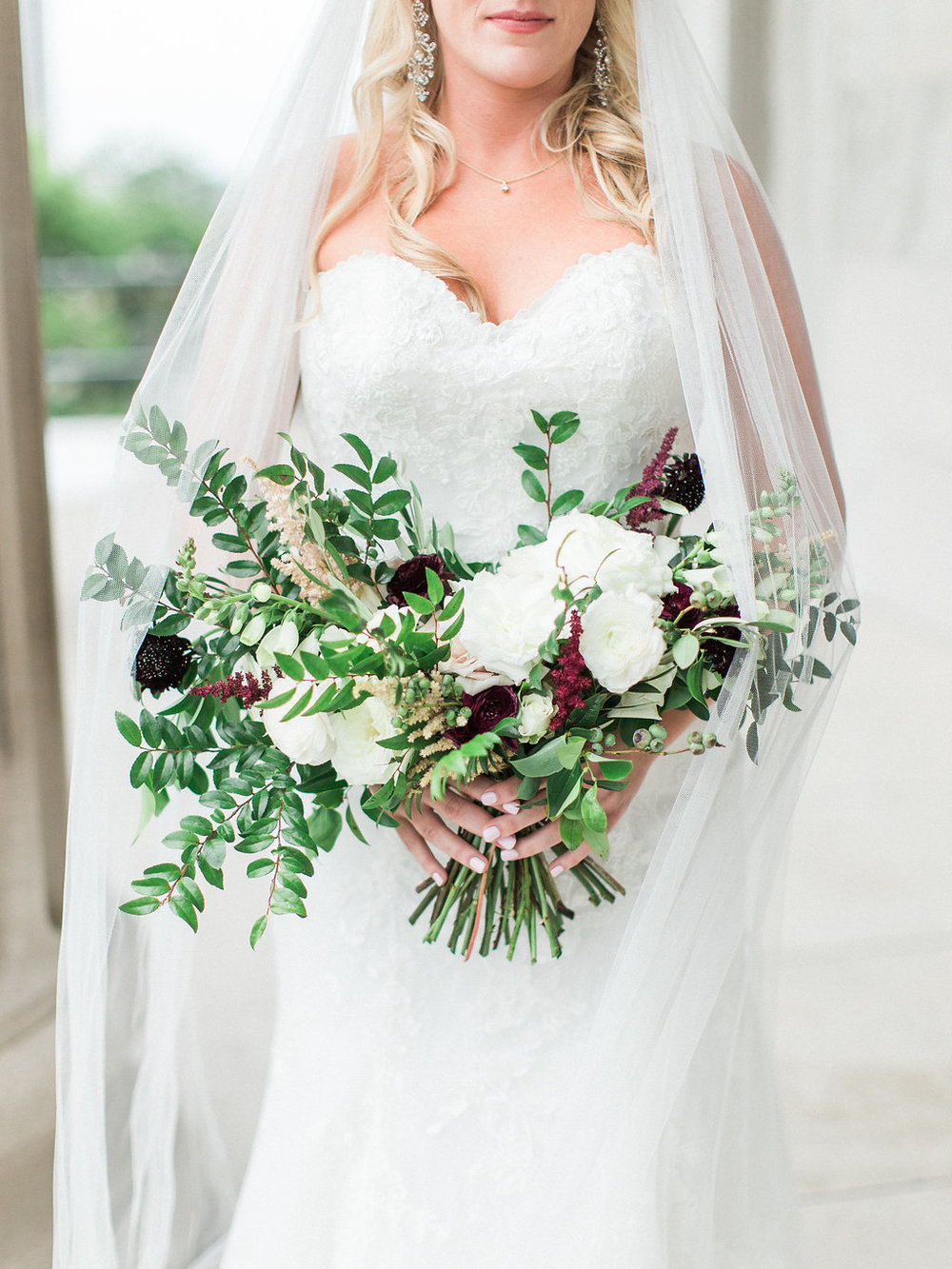 Loose, unstructured bridal bouquet with white, blush, neutral flowers and accents of burgundy // Nashville Wedding Floral Design