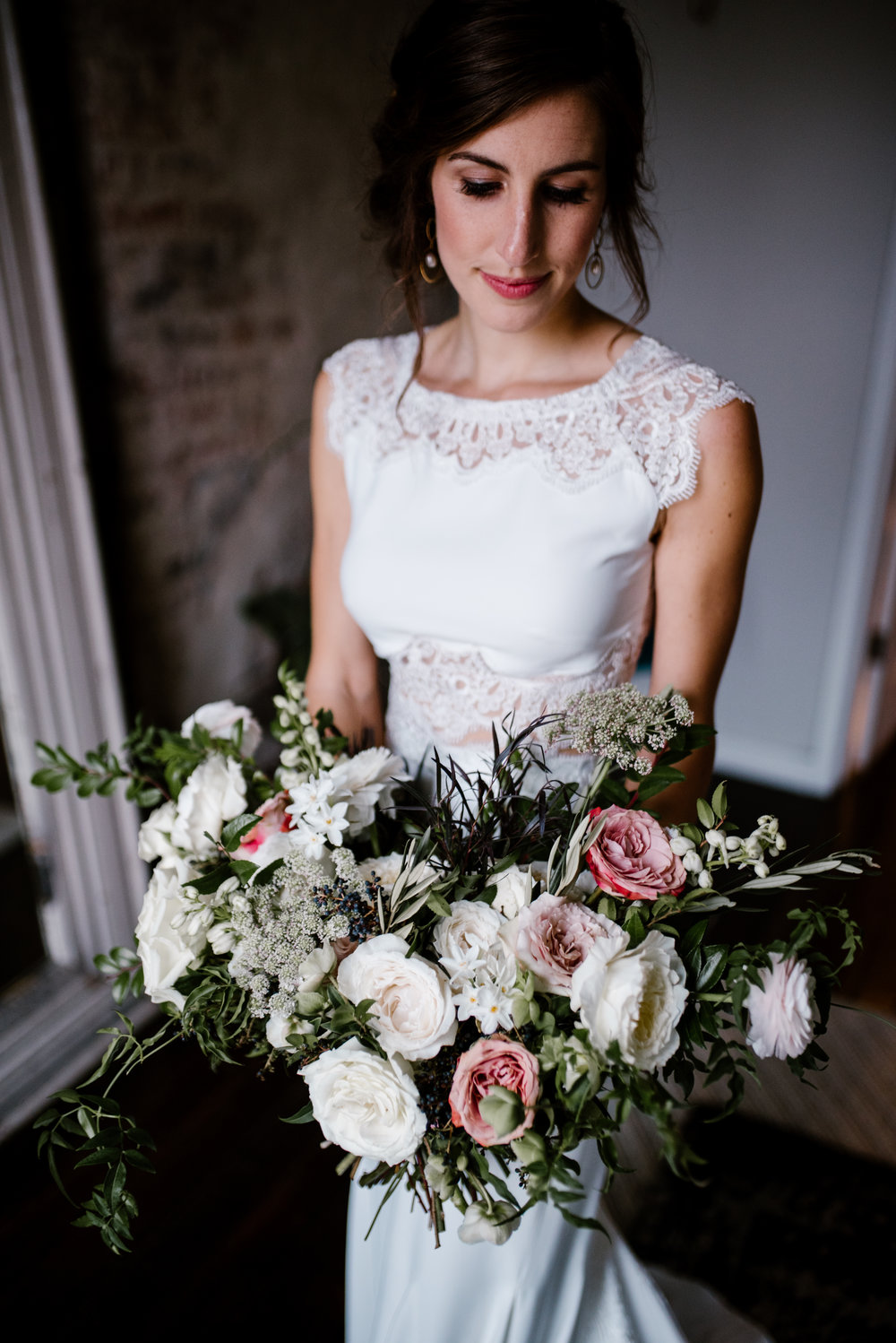 Natural, untamed wedding flowers with garden roses, ranunculus, and wildflowers // Southeastern Wedding Floral Designer